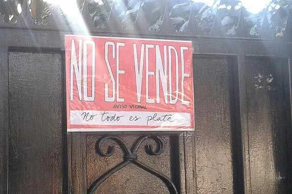 Con letreros de 'no se vende' vecinos de �u�oa frenan acoso de inmobiliarias
